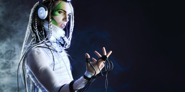 Shot of a futuristic young man in headphones and with wires.