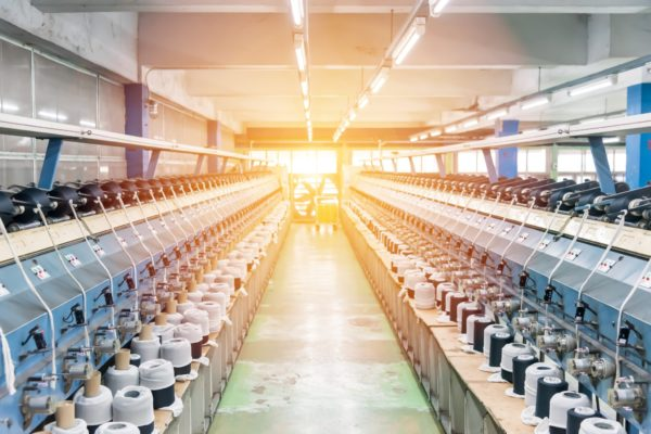 machines for weaving yarns used in industrial factories. Modern technology in spinning yarn.