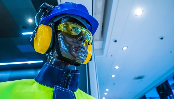 Protective equipment on a mannequin. Specialist clothes. Protective helmet. Antinoise headphones. Protective glasses. Personal protective equipment. Safety at work.
